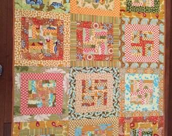 Handmade quilt using Amy Butler fabric