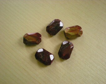 set of red gold resin beads
