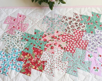 pretty hand sewn and quilted pinwheel table topper