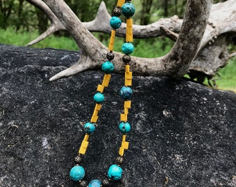 Turquoise Magnesite necklace with yellow beads and brass accents.