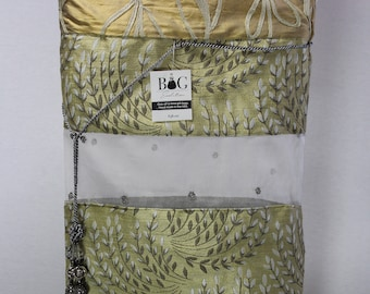 Gold, blue woven fabric with leaves, sheer fabric with gray beading and gray crystal tassel gift bag