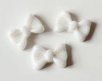 10x7mm white glittery bow cabochon