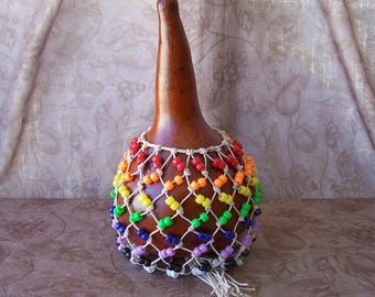 Medium Brick gourd shekere instrument.  1953
