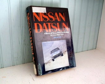 Vintage 1982 book NISSAN / DATSUN A History of Nissan Motor Company in USA 1960 - 1980 John B. Rae 1982 Hardback with Dust jacket