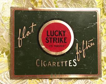 "Vintage ""Flat Fifties"" Lucky Strike cigarette tin, c.1930"