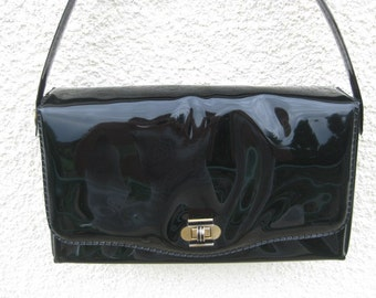 French black lacquer plastic handbag without shoulder strap.