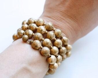 1930s art deco brass beaded wrap bracelet / 30s vintage brass coil bangle / antique brass wrapped bead patina bracelet