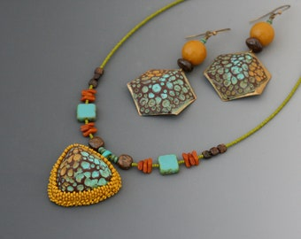 Polymer clay and vintage metal earring and necklace jewelry set. Glass beads, vintage beads, bronzite. Turquoise, mustard yellow, pea green.