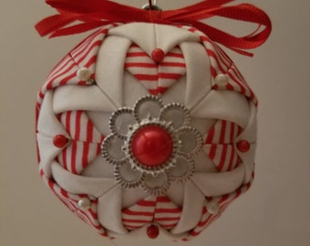 Red and White Folded Fabric Ornament with a Flower Decoration
