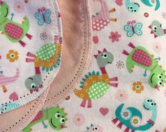 Pink Dinosaur hemstitch flannel baby blanket and burp cloth, double sided flannel receiving size 36x40. Perfect swaddle.