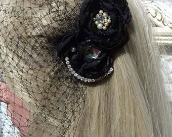 Black flower, bird cage veil fascinator