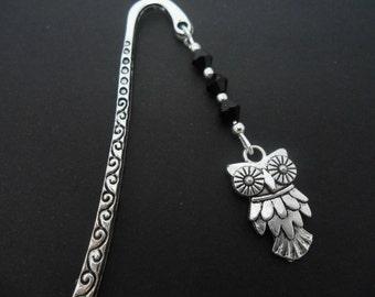 A tibetan silver owl  bookmark.