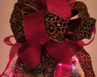 Large Christmas Tree topper bow made with a  Leopard/ animal print and a red shimmering ribbon