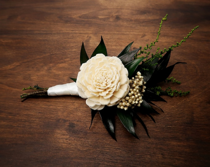Wooden flower wedding boutonniere in ivory and green