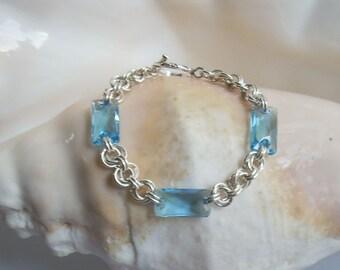 Bracelet: Sparkling Blue Aquamarine Swarovski Crystals on Argentium Flower Chain