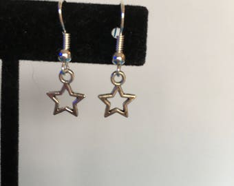 Tiny delicate silver star earrings