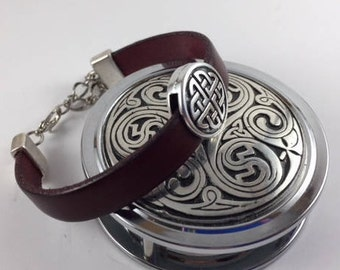 Celtic disk with adjustable silver closure on three different colors of Italian leather.