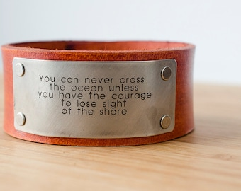 You can never cross the ocean unless you have the courage to lose sight of the shore - Custom Leather Cuff with Engraved Metal Plate