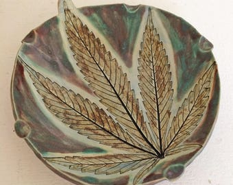 420 Ware ~ Round Fantastic, in greens, golds and blues, with glow.