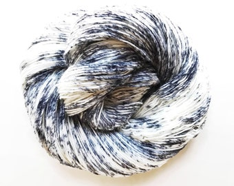 NEWSPRINT hand dyed yarn speckle. choose your base from fingering, sock, dk, or bulky yarn. soft merino wool. black and white speckle yarn