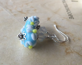 Blue floral lampwork earrings in sterling silver