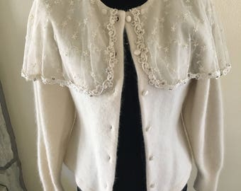 Ivory sweater with lace shawl collar