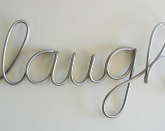 laugh aluminum metal sign
