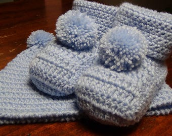 Baby booties and hat with pom poms