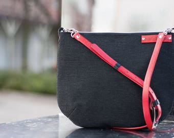 black messenger bag, crossbody bag with red adjustable strap, zippered shoulder bag, black small bag with leather, fabric crossbody bags
