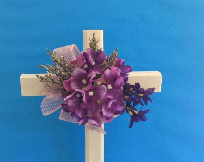 Cemetery cross, white and purple cemetery flowers, floral memorial, grave decoration, memorial cross