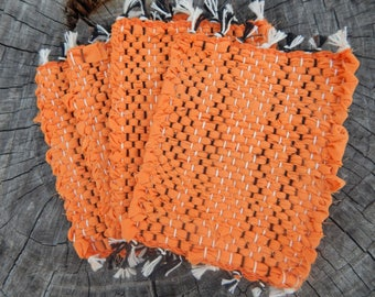 Solid orange set of four handwoven mug rugs, coasters, hot pads