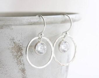 Silver hoop earrings - hammered silver circles with CZ charms, small silver drop earrings, silver April birthstone earrings, gift for her