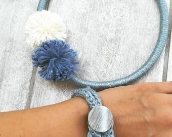 Cord blue necklace with pom pom and bracelet with button