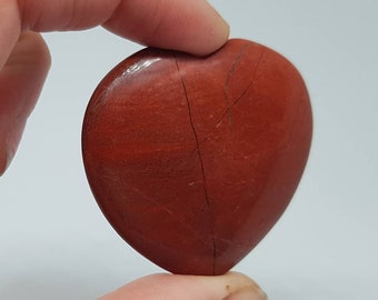 Red jasper stone carved heart.