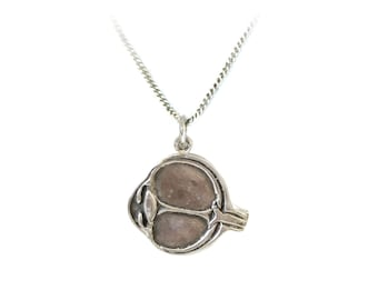 Anatomical Eye Necklace in sterling silver by medical artist Beth Croce