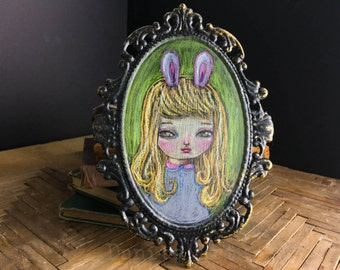 Portrait of a fluffy bunny, conte pencil pastel drawing on metal frame. A pop surreal self portrait of Danita with pink hairy rabbit ears.