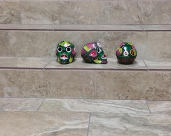 Ceramic sugar skulls. sugar skulls. handpainted sugar skulls. halloween decor. skeleton skulls.skulls. handpainted skulls.green sugar skulls