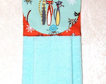 Mid Century Atomic Cats Hand Towel in Aqua and Coral
