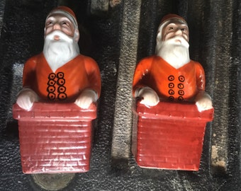 Pair of matching Santas with hand painted accents and decorations