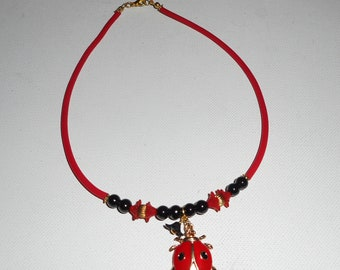 Necklace Ladybug child in red enamel with glass beads on buna cord