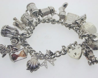 "Silver charm bracelet 16 charms, most opening 7"" heavy 81.5 grams heart padlock"