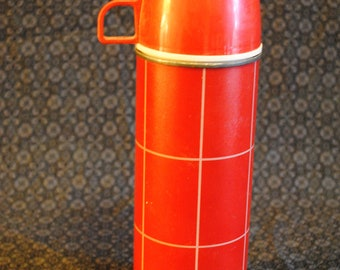 Red Genuine Thermos brand Revelation vacuum bottle