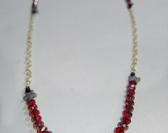 Handmade necklace with star hematite elements and gold steel chain.Red crystal beads .Best gift for her!!