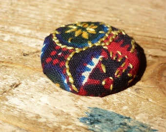 Multicolored African fabric embroidered badge