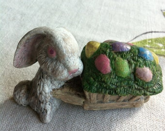A ceramic rabbit pushing a cart full of eggs with a removal lid on the cart trinket dish