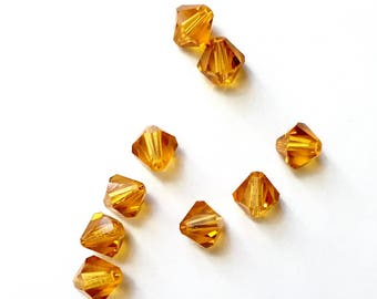 15 4 mm Topaz Swarovski Crystal bicone beads