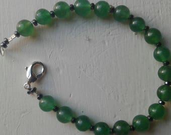 Aventurine beaded bracelet with hematite spacing beads.