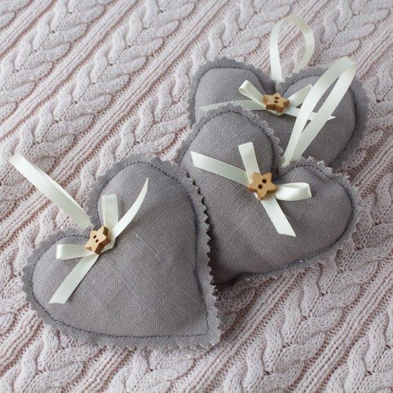 Three little linen hanging hearts.