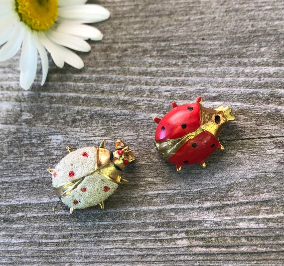 Two Adorable Teeny Red and White Lady Bug goldtone insect Pins one is marked Korea