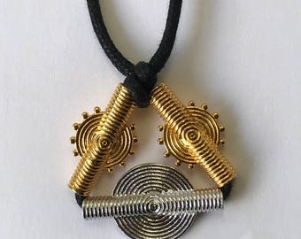 Black necklace with a 2 beads in vermeil 1 bead in silver.